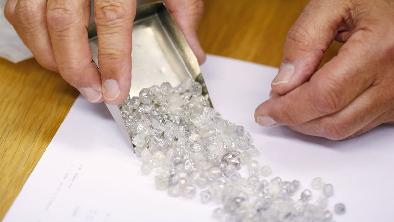 Diamond buyer Elliot Tannenbaum, from the Leo Schachter Diamond Group, looks at uncut diamonds from his company's allocation at a sightholders week at De Beers offices in central London