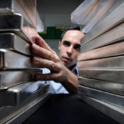Gregor Gregersen, director of Silver Bullion Pte., arranges a stack of silver bullion bars at the company's office in Singapore, on Thursday, Oct. 4, 2012. Silver, this year's best performing precious metal, has increased 19 percent in 2012 amid investor demand for a hedge against inflation. Photographer: Munshi Ahmed/Bloomberg *** Local Caption *** Gregor Gregersen